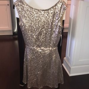 Sequin open back skater dress never worn